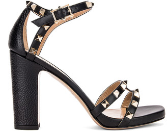 Valentino Rockstud Ankle Strap Sandals in Nero | FWRD
