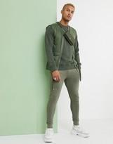 Asos Design DESIGN mesh utility vest in khaki