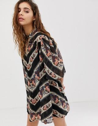 Asos DESIGN collar mini swing dress in 70s paisley stripe