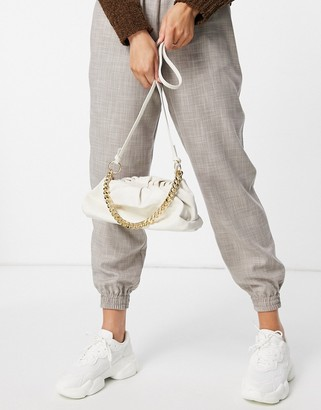 Truffle Collection slouchy pillow bag with chunky chain in cream