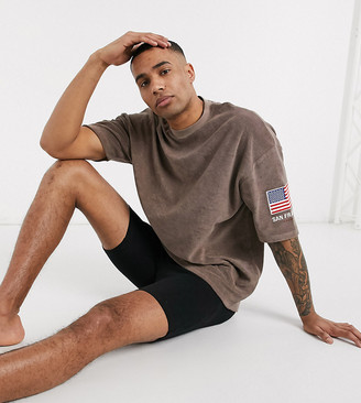 Asos DESIGN Tall oversized longline t-shirt with flag sleeve embroidery and city print in towelling