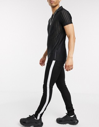 Asos Design DESIGN super skinny jeans in black with white side stripe