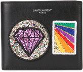 Saint Laurent Paris multi patch wallet - men - Leather - One Size