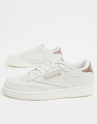 Reebok Club C 85 trainers in white with pink leopard print heel detail