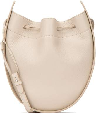 The Row Round Pouch Crossbody Bag