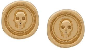 Northskull Atticus skull seal earrings