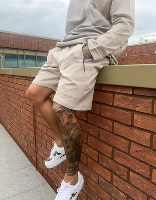 Mennace pannelled shorts co-ord with tech pockets in beige