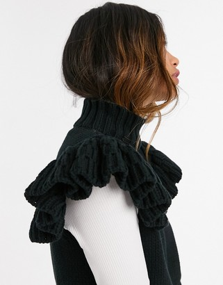 Y.A.S knitted vest with high neck and ruffle sleeves in black