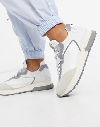 Ash Tiger runner trainers in white and grey