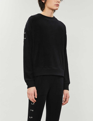 Eyelet-detail stretch-knit jumper