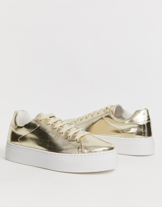 ASOS DESIGN Day Light chunky flatform lace up sneakers in gold