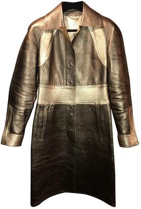 Gucci Gold Leather Coats