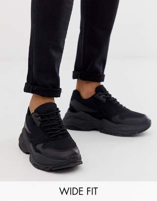 Asos Design DESIGN Wide Fit trainers in black mix with chunky sole