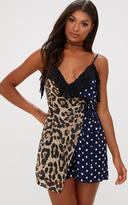 PrettyLittleThing Navy Mixed Print Playsuit