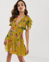 Asos DESIGN mini dress with godet lace inserts in yellow floral print