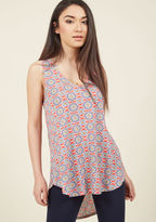 FT-5660 Every fashionista knows the necessity of pieces that can be infinitely styled, and this bright red top promises unlimited options. This V-neck's high-low hem and ultra-soft jersey knit pair with a blue, yellow, and ivory medallion pattern to assure boundl