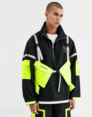 Taka Original utility jacket with reflective taping and neon pockets