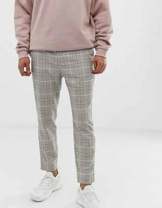 Bershka skinny trousers with houndstooth print in beige