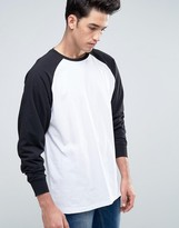 Asos Oversized Longline Long Sleeve Raglan T-Shirt With Curved Hem In White/Black