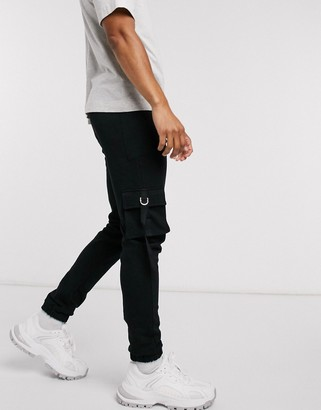 ASOS DESIGN utility skinny joggers in black with strapping details and tie hems