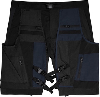 White Mountaineering Black and navy panelled shell shorts