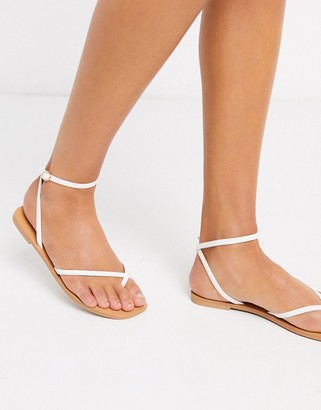 ASOS DESIGN Farnborough minimal toe loop flat sandals in white