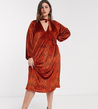 Asos DESIGN Curve animal velvet tie neck midi dress in red