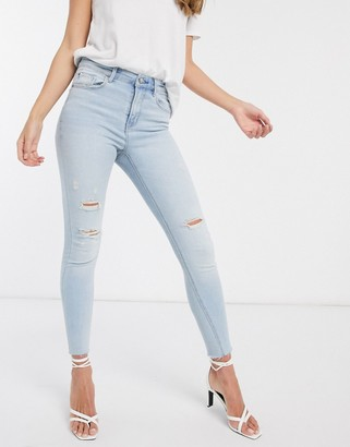 Stradivarius high waist jeans with rips in light blue wash