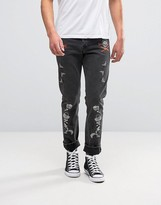 Asos Slim Jeans With Emboirdery Patches In Washed Black