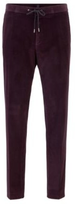 Slim-fit pants in cotton with elastic waistband
