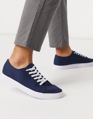 ASOS DESIGN Wide Fit trainers in navy canvas