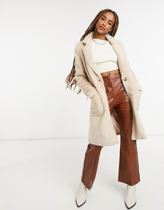 Only faux fur longline coat with pocket detail in cream