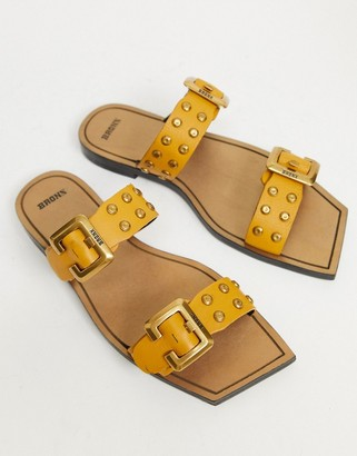 Bronx big buckle square toe slip on mules in mustard leather