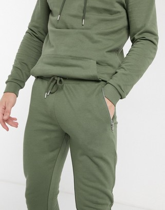 ASOS DESIGN organic super skinny joggers in khaki with silver zip pockets