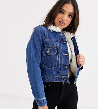 Asos DESIGN Petite denim jacket with borg lining in blue