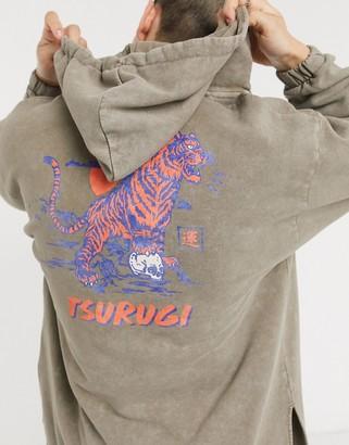 ASOS DESIGN oversized V neck hoodie with split hem & back print with wash