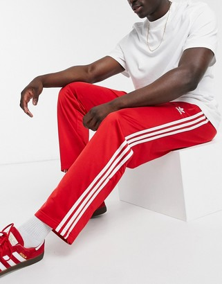adidas firebird sweatpants in red