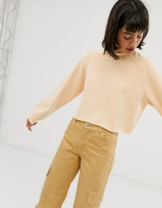 Monki long sleeves cropped sweatshirt in peach
