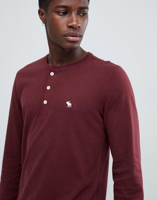 Abercrombie & Fitch icon logo long sleeve henley top in burgundy-Red