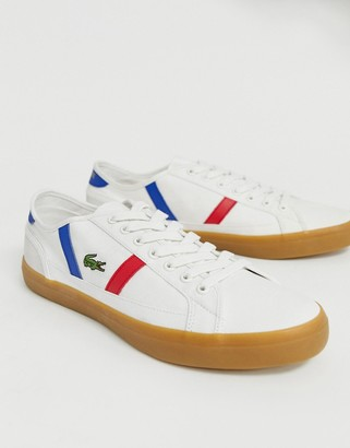 Lacoste Sideline plimsolls in off white canvas