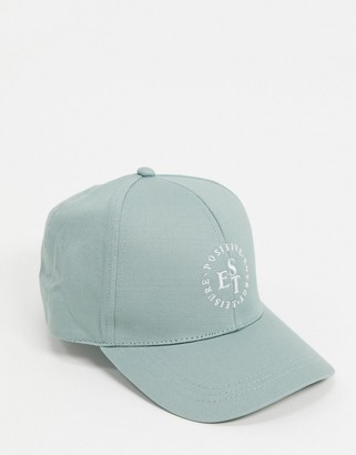 ASOS DESIGN baseball cap with logo in mint