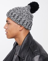 Asos Design DESIGN bobble beanie in chunky knit in white and black twist