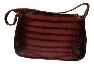 Saint Laurent Burgundy Leather Clutch bags