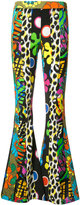 Moschino psychedelic printed flared trousers - women - Rayon/Other fibres - 40