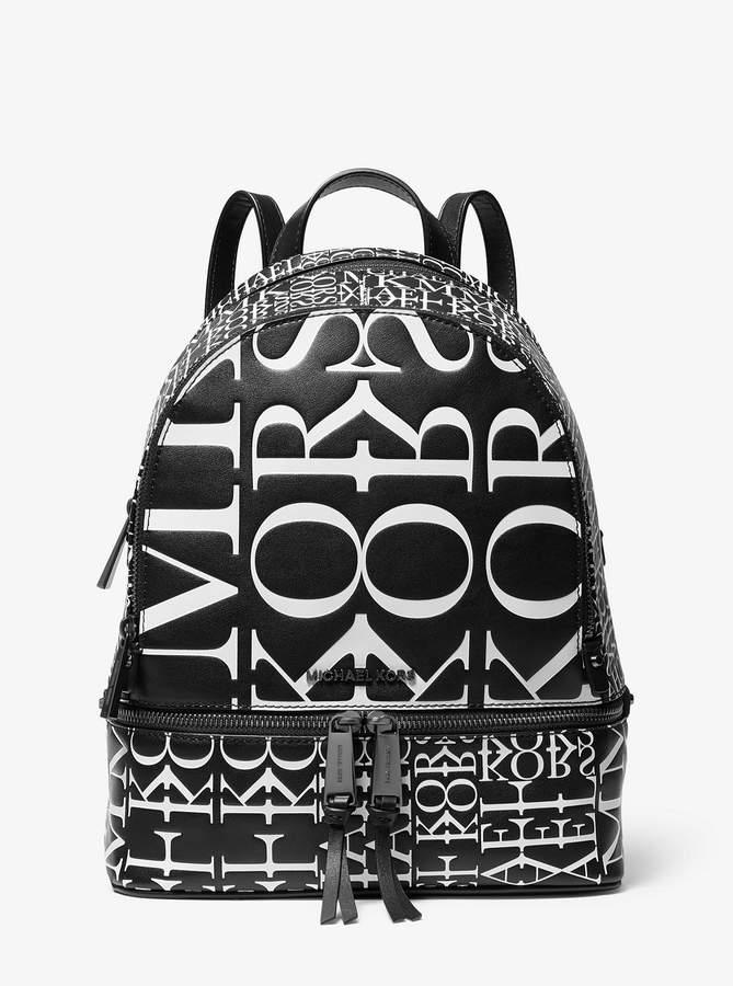 b8d0b658c6d Rhea Medium Newsprint Logo Leather Backpack