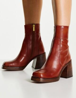 ASOS DESIGN Region leather mid heel boots in tan