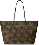 eva longoria  Who made  Eva Longorias black cat sunglasses, brown print handbag, and hot pink flip flops?