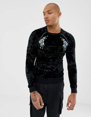 Asos Design DESIGN muscle sweatshirt in velour with floral embroidery and gold piping-Black