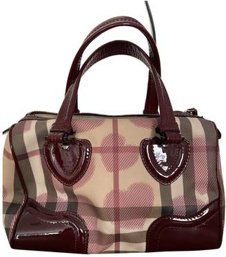 Burberry Burgundy Patent leather Handbags