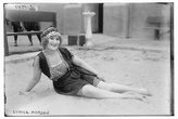 Historic Photographs Photo: Eunice Morgan,sand,bathing suits,headband,bench,women,portrait,Bain News Service